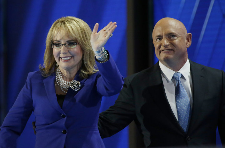 Former Rep. Gabby Giffords (D-AZ) leaves the stage with her husband retired Navy Captain Mark Kelly at the Democratic National Convention in Philadelphia, Pennsylvania