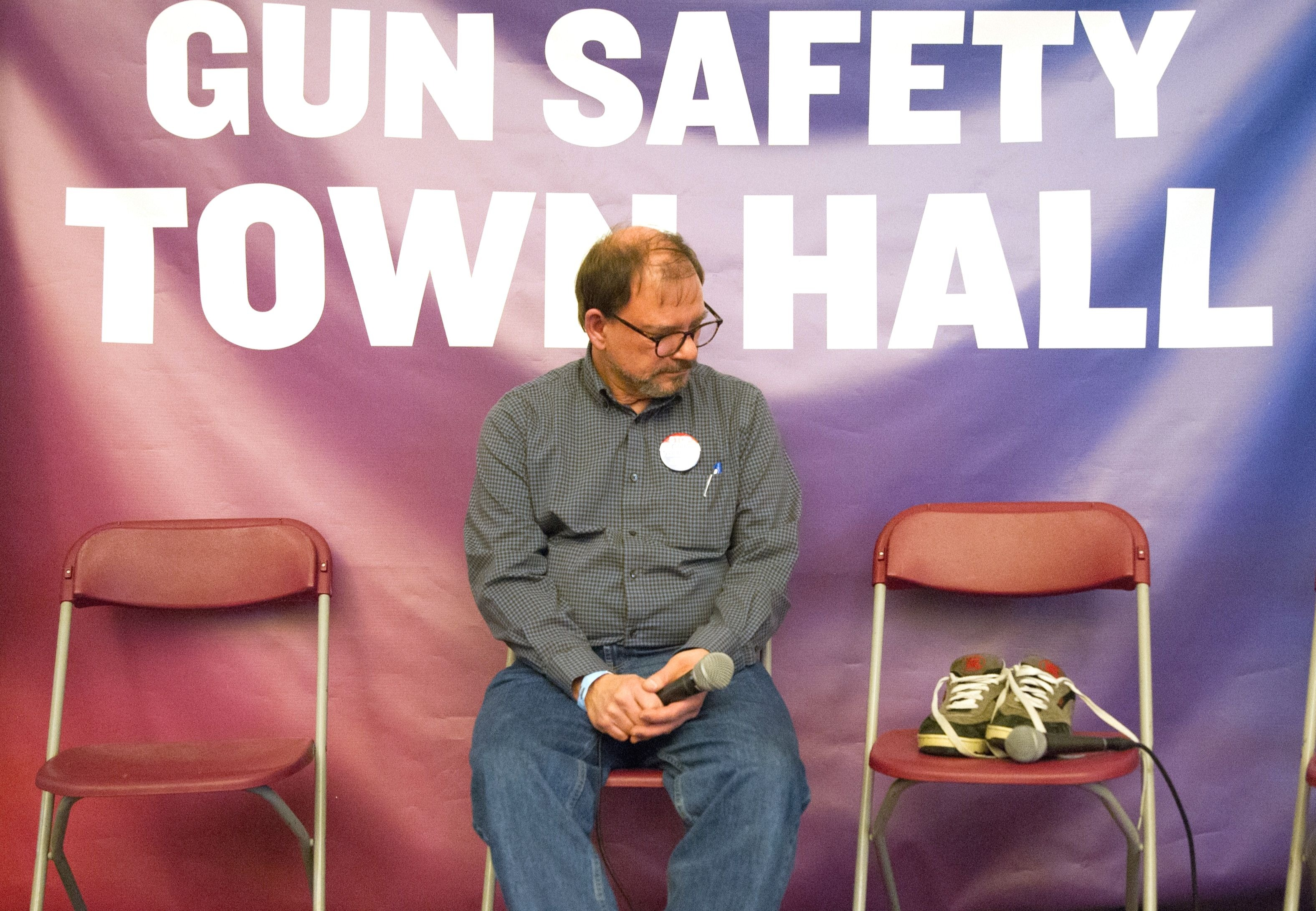 Tom Mauser sits next to the shoes his son Daniel was wearing when he was murdered at Columbine 20 years ago.