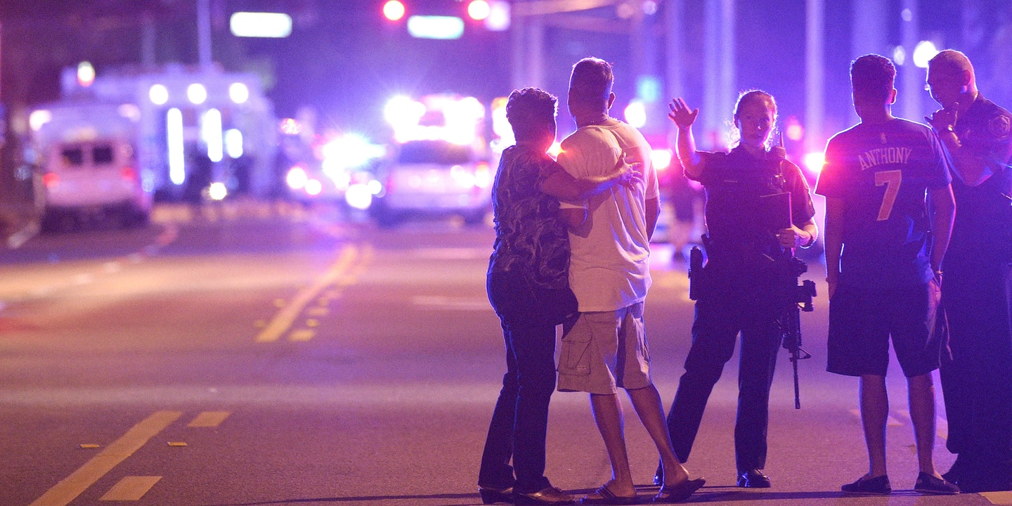 Police direct people away from the scene of the shooting at Pulse nightclub in Orlando, Florida on June 12, 2016. (AP Photo/Phelan Ebenhack)